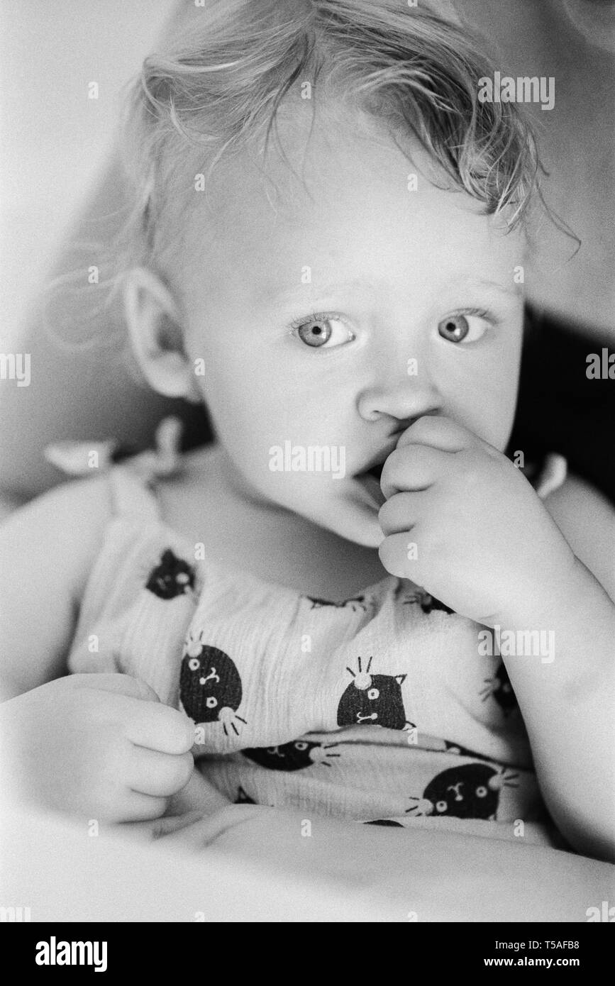 A dreamy baby girl - Stock Image
