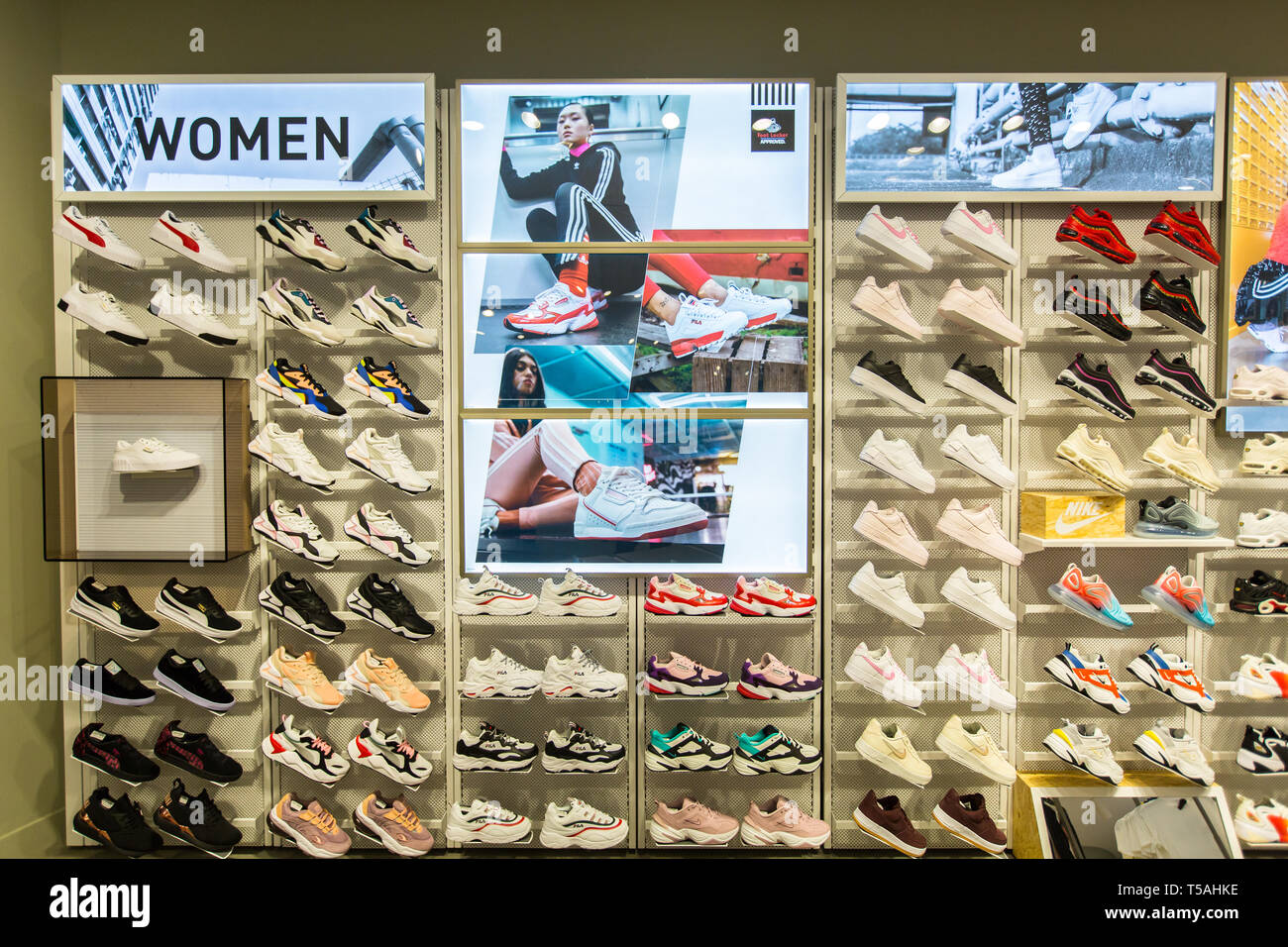 a9b08529b Women sports shoes or sneakers on display neatly in Foot Locker outlet