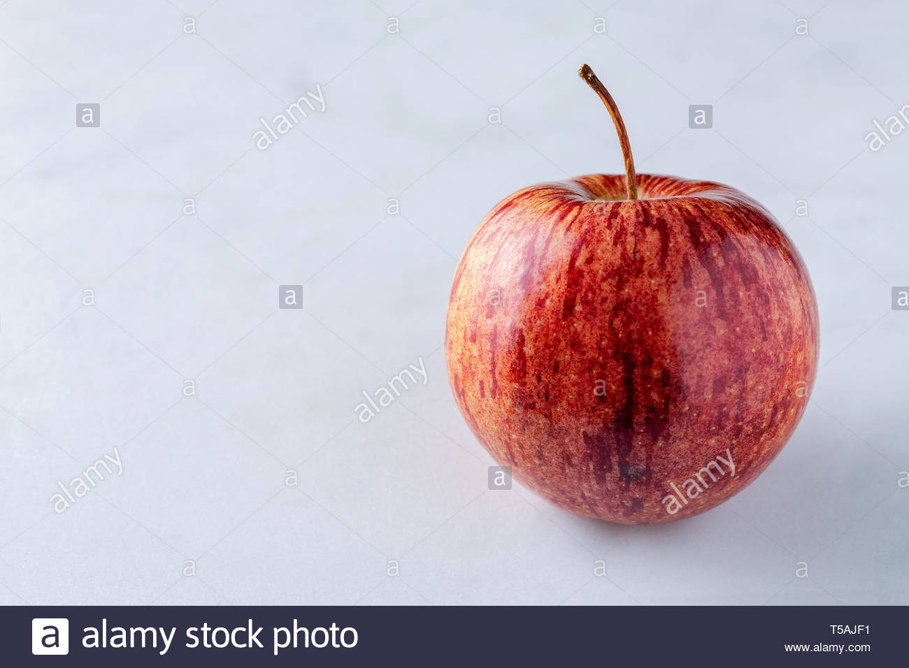Apple Close Up Shot Of Apple Skin Showing Pattern And Texture With Stem And Copy Text Space To Left Stock Photo Alamy