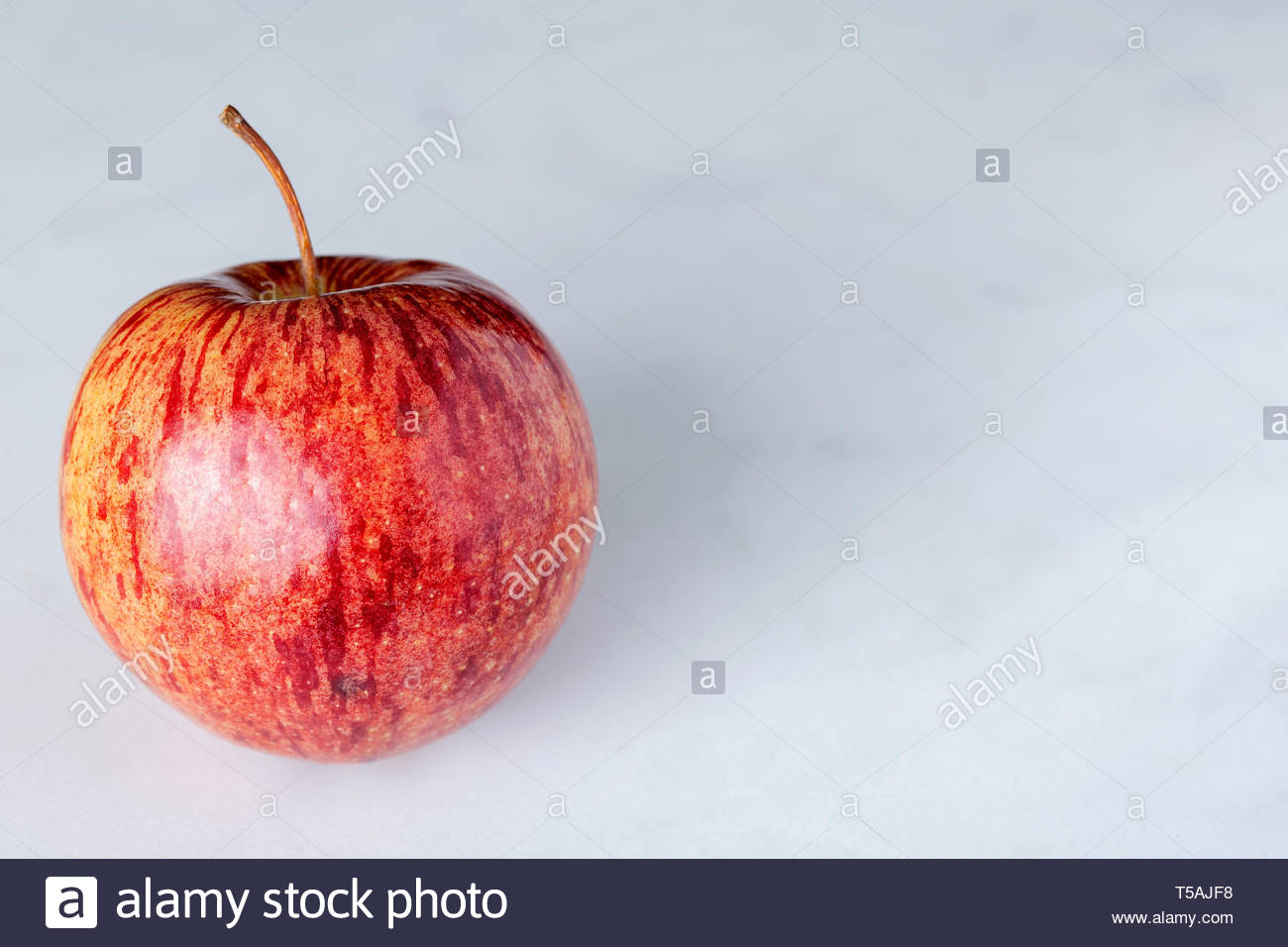 Apple Close Up Shot Of Apple Skin Showing Pattern And Texture With Stem And Copy Text Space To Right On Marble Background Stock Photo Alamy
