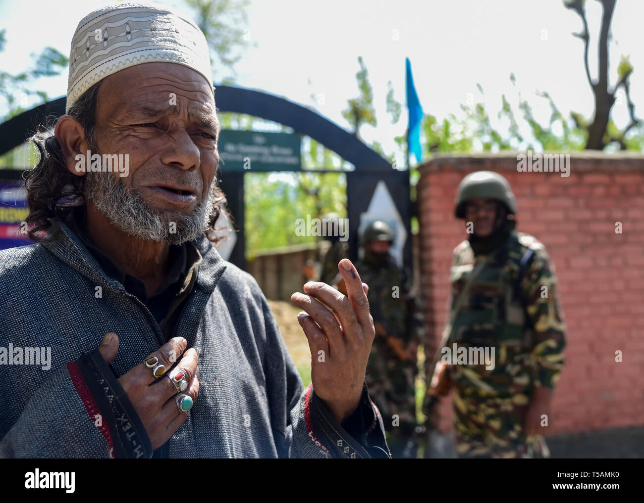 A Kashmiri voter seen showing off his inked finger after casting his vote at a polling station in Anantnag, South Kashmir. On the third phase of India's Parliamentary elections, Indians went to polls amid complete shut down and internet gag. Stock Photo
