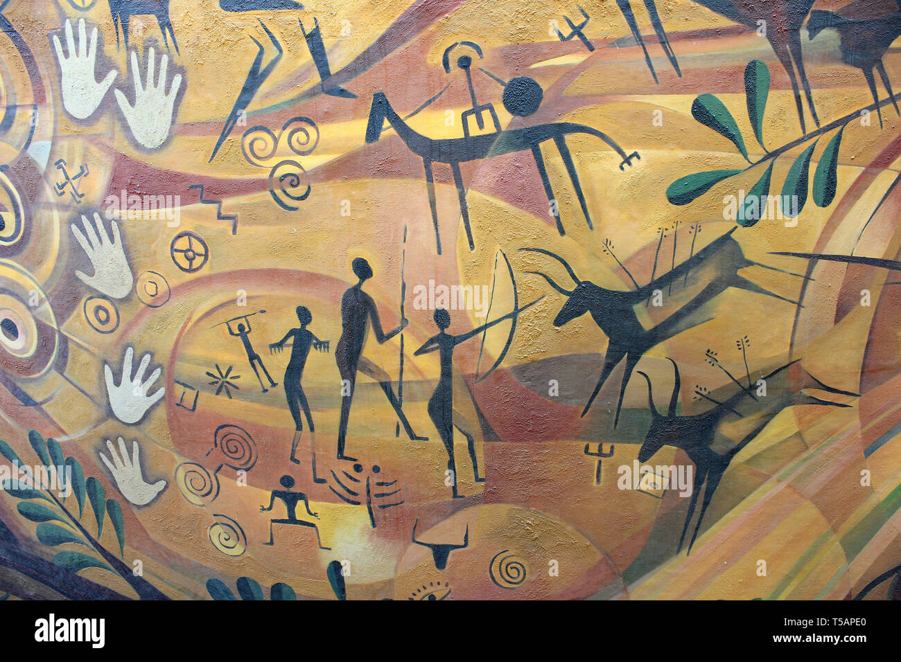 Modern Art in the style of a Cave Painting depicting Prehistoric Hunting and Hand Prints - Stock Image