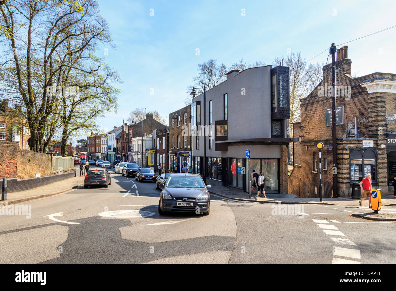 Modern architecture meets traditional Georgian style in Highgate Village, London, UK, on a warm and sunny Easter weekend - Stock Image