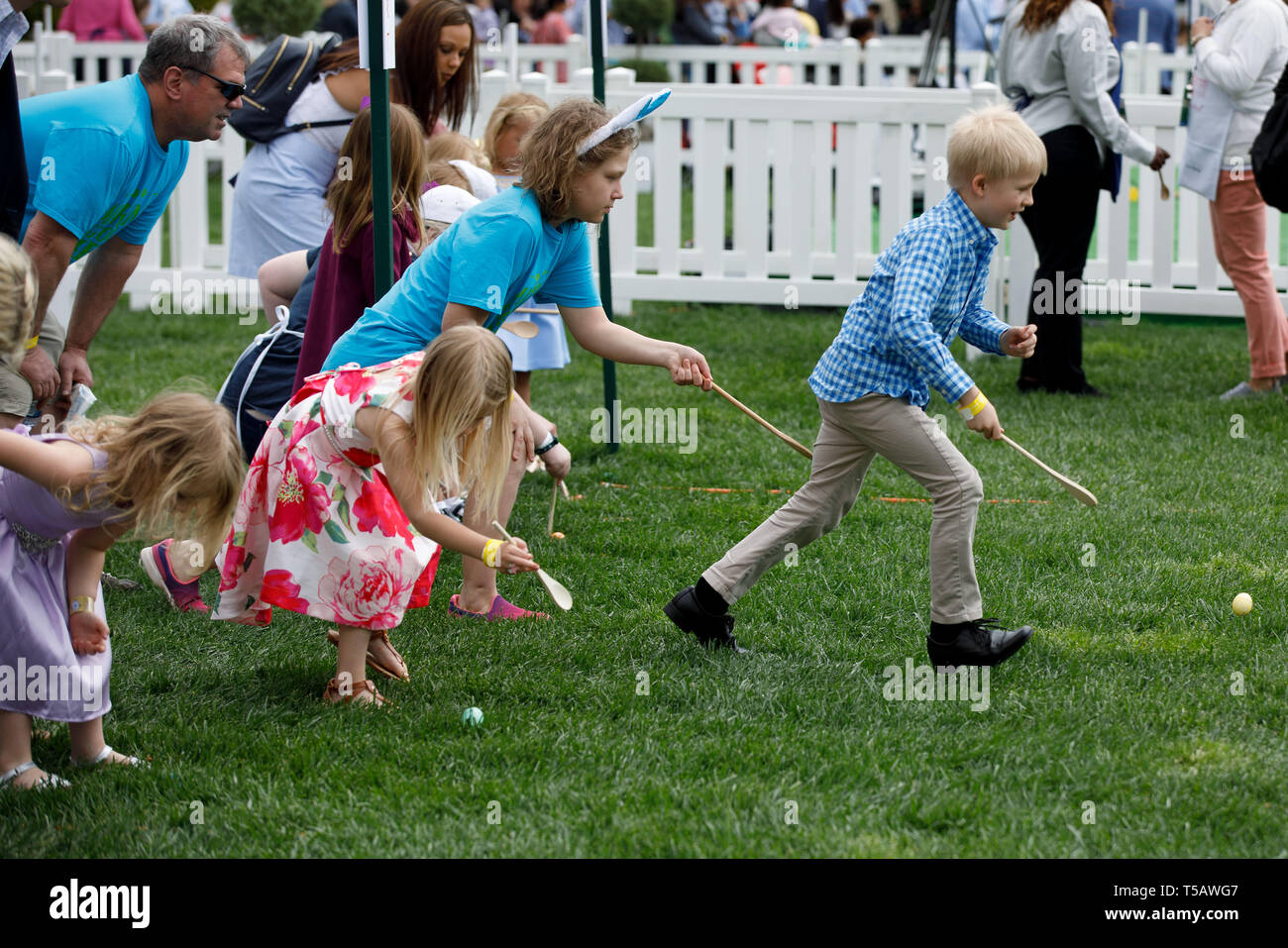 Washington, USA. 22nd Apr, 2019. Children take part in the annual Easter Egg Roll at the White House in Washington, DC, the United States, on April 22, 2019. White House Easter Egg Roll was held on the South Lawn on Monday as the annual tradition entered its 141st year. Credit: Ting Shen/Xinhua/Alamy Live News Stock Photo