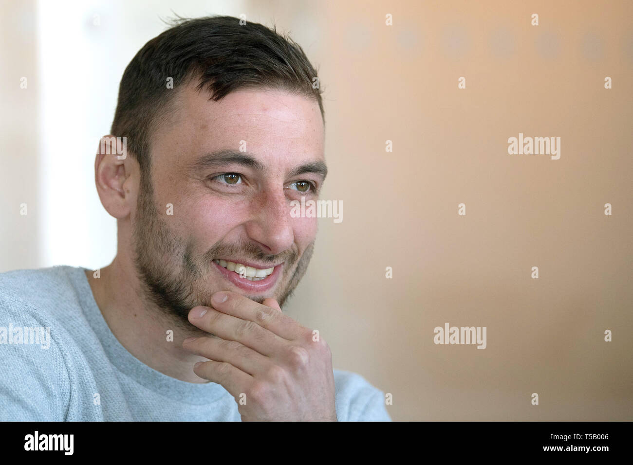 "16 April 2019, North Rhine-Westphalia, Düsseldorf: Alexander Scheelen, regional league soccer player from Rot-Weiß Oberhausen, talks to editors in the DPA editorial office. The man from Oberhausen received a shock diagnosis of lymph gland cancer a year ago. Today, the 31-year-old is back on the pitch after having survived illness, even scored an important goal and hopes to be promoted to the third league with RWO. (to dpa ""Alexander Scheelen: ""I had put the subject of football aside"""") Photo: Federico Gambarini/dpa Stock Photo"