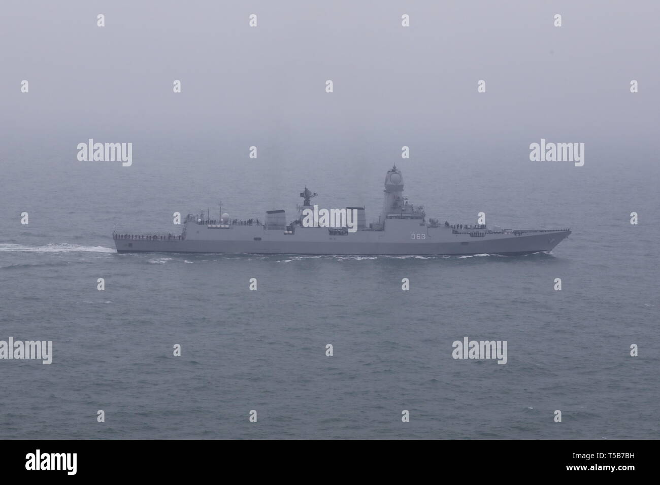 Qingdao. 23rd Apr, 2019. Aerial photo taken on April 23, 2019 shows Indian Navy destroyer INS Kolkata in the waters off Qingdao, east China's Shandong Province. The vessel was here for a naval parade staged to mark the 70th founding anniversary of the Chinese People's Liberation Army (PLA) Navy on Tuesday. Credit: Ju Zhenhua/Xinhua/Alamy Live News - Stock Image