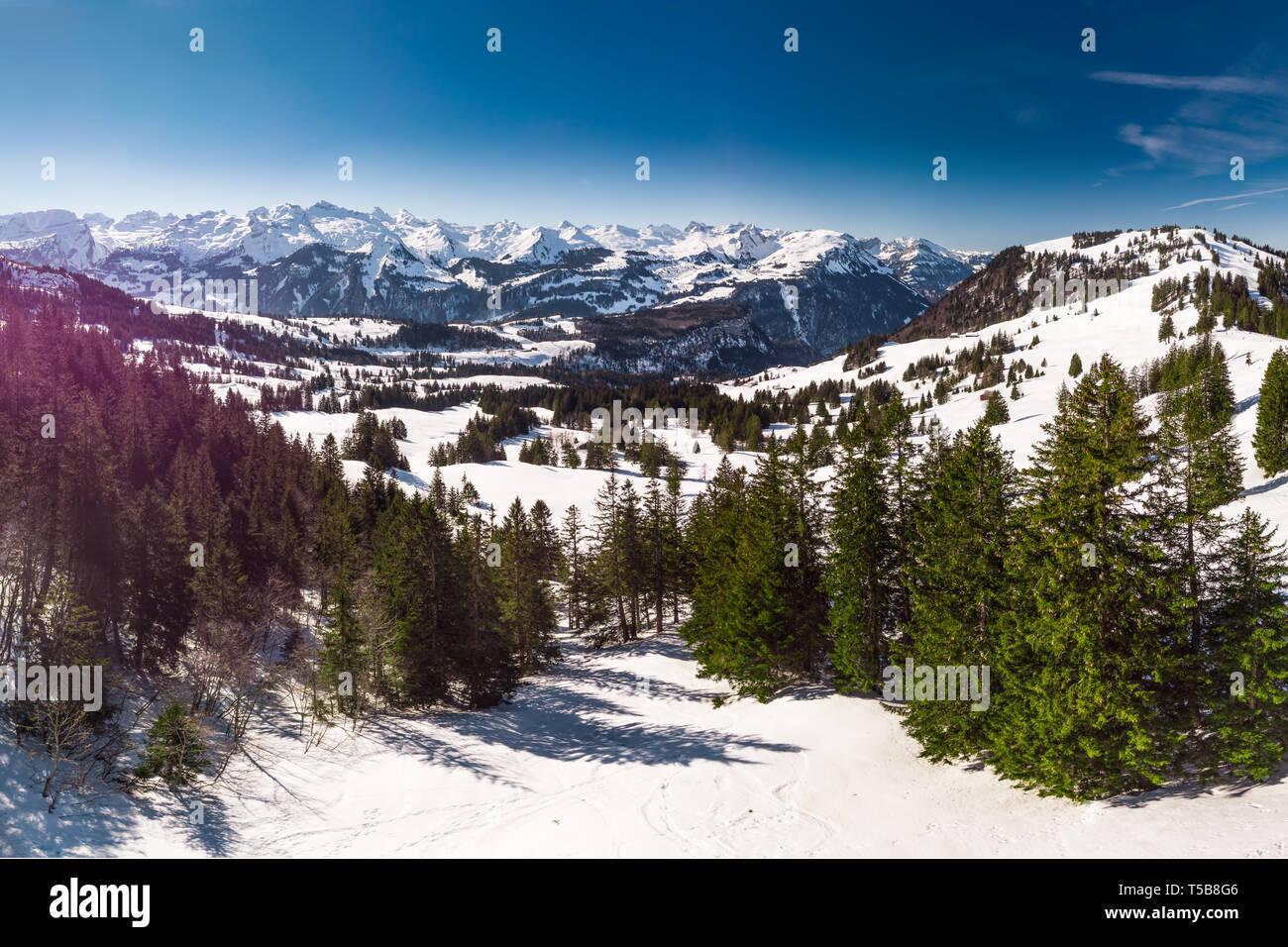 Beautiful winter landscape. People skiing in Mythenregion ski resort, Ibergeregg, Switzerland, Europe. - Stock Image