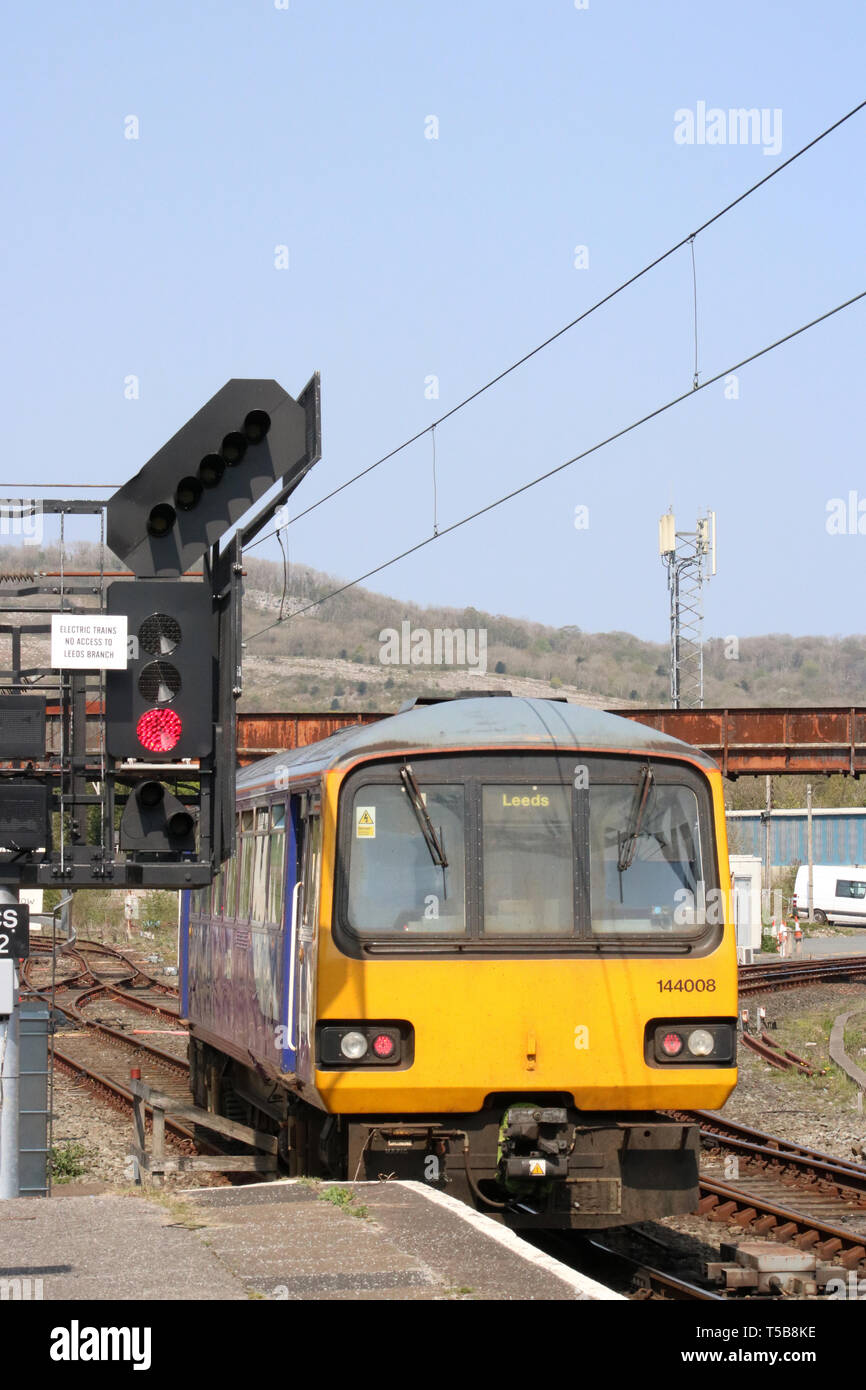 Two car class 144 Pacer diesel multiple unit passenger train in Northern livery leaving Carnforth railway station on 22nd April 2019. - Stock Image