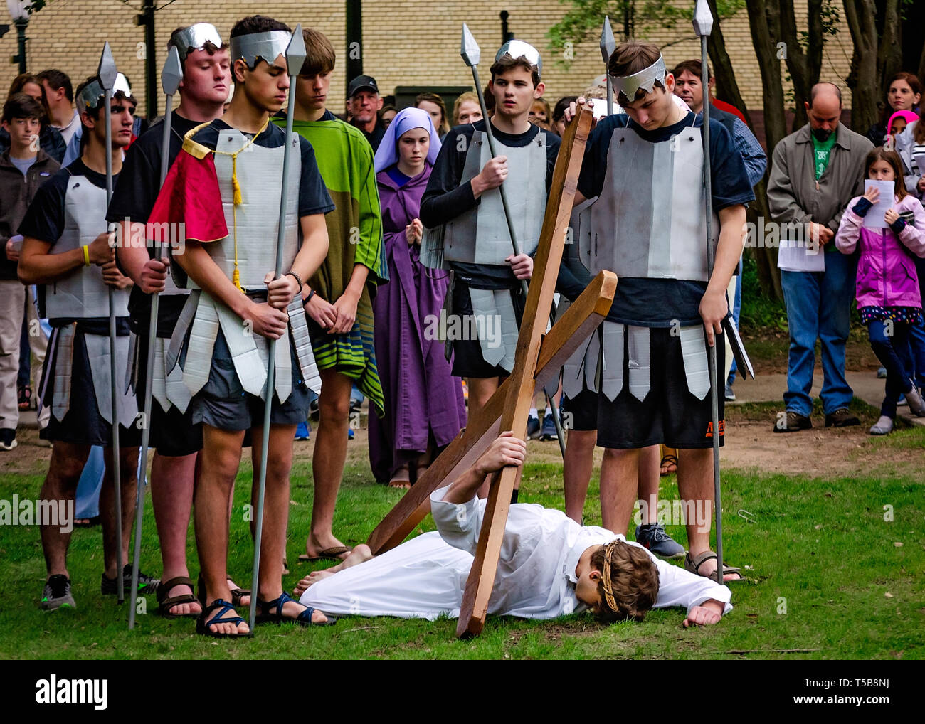 Members of the St. Dominic Youth Group re-enact the Stations of the Cross during a Good Friday procession, April 19, 2019, in Mobile, Alabama. - Stock Image
