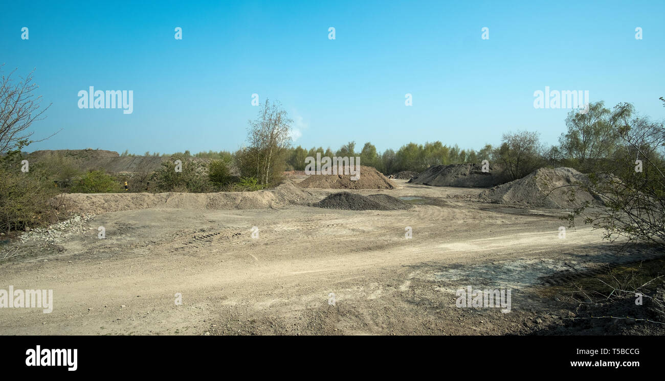 Barren quarry dumping landscape - Stock Image