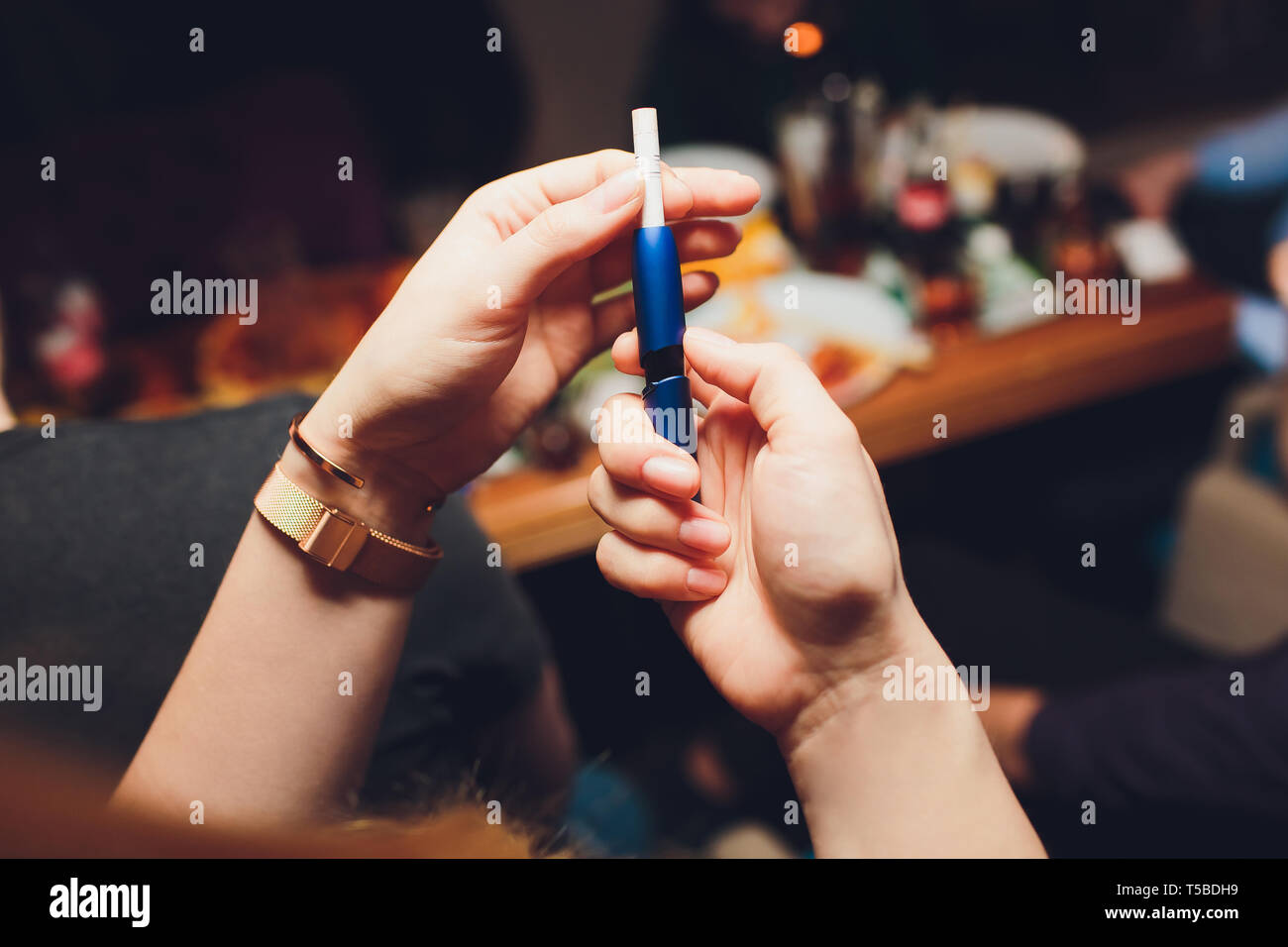 New design. Showcase with a large multi-colored selection System of heating of tobacco. Color devices for smoking. New technology of electronic - Stock Image