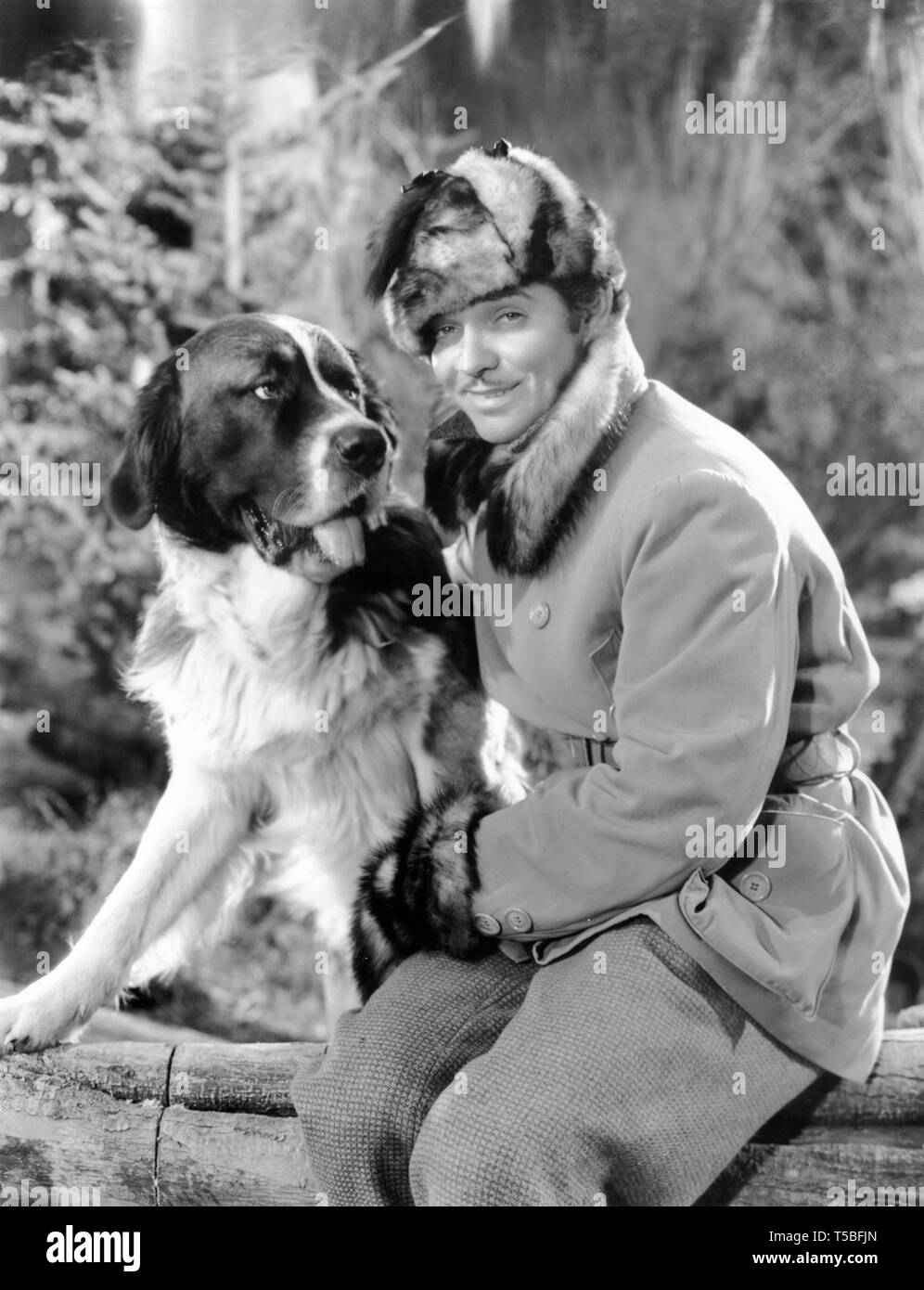 CLARK GABLE as Jack Thornton with BUCK the Sled Dog THE CALL OF THE WILD 1935 director William A. Wellman novel Jack London producer Darryl F. Zanuck 20th Century Pictures / United Artists - Stock Image