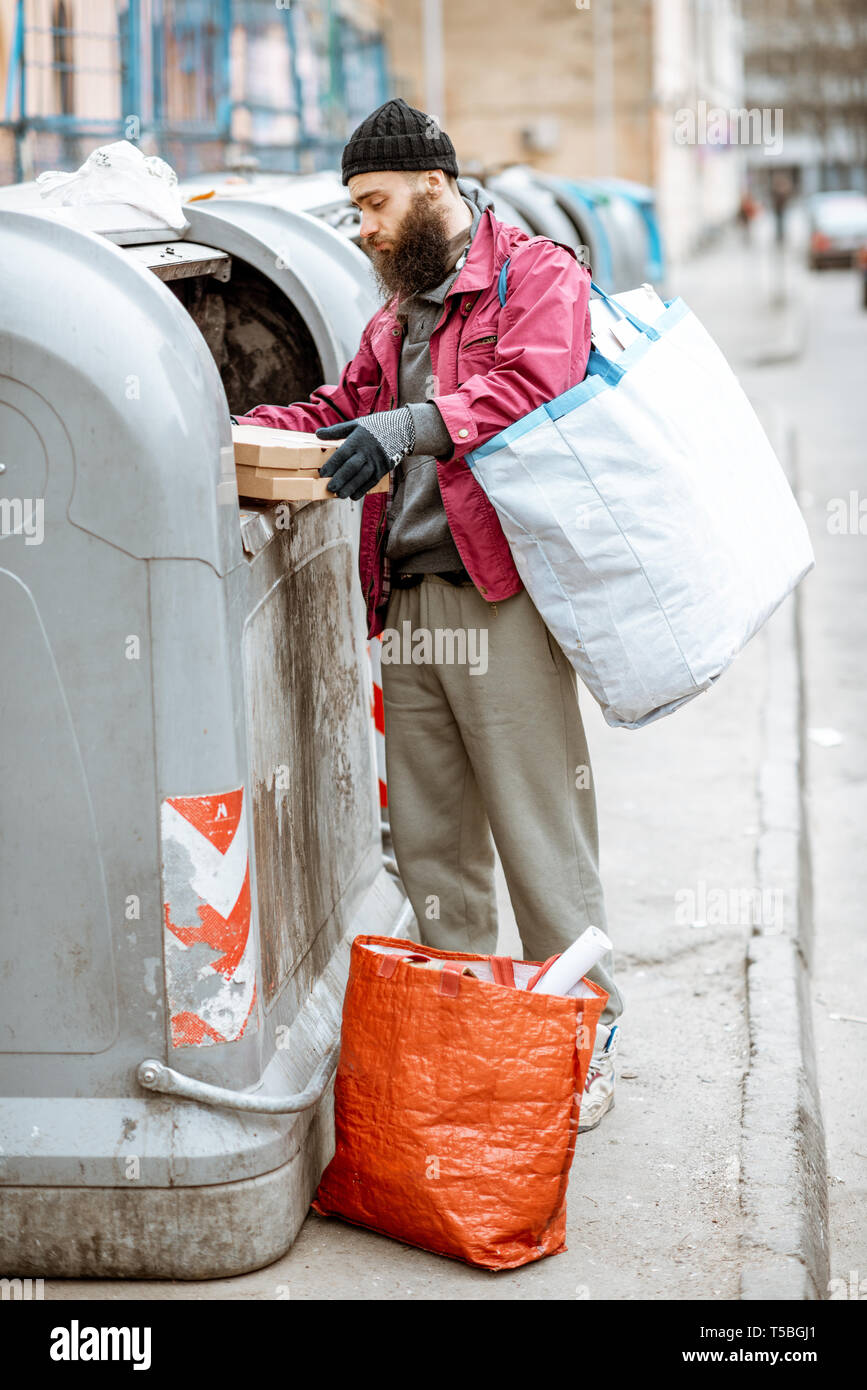 Homeless Man Looking Food In High Resolution Stock Photography and ...