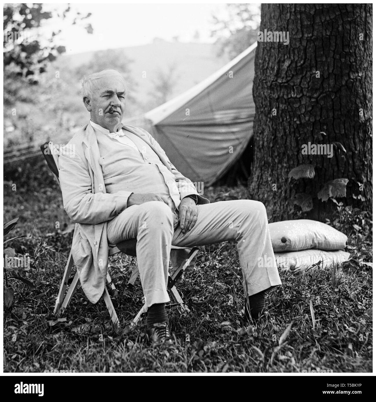 Thomas Edison (1847-1931), portrait relaxing in a chair outdoors, National Photo Company, 1921 Stock Photo