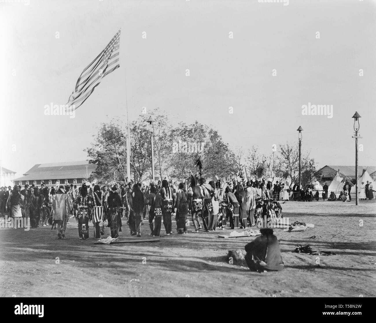 Ghost Dance, Cheyennes & Arapahoes in Circle around Flagpole, Indian Congress of the Trans-Mississippi and International Exposition, by Adolph F. Muir, F.A. Rinehart, 1898 - Stock Image