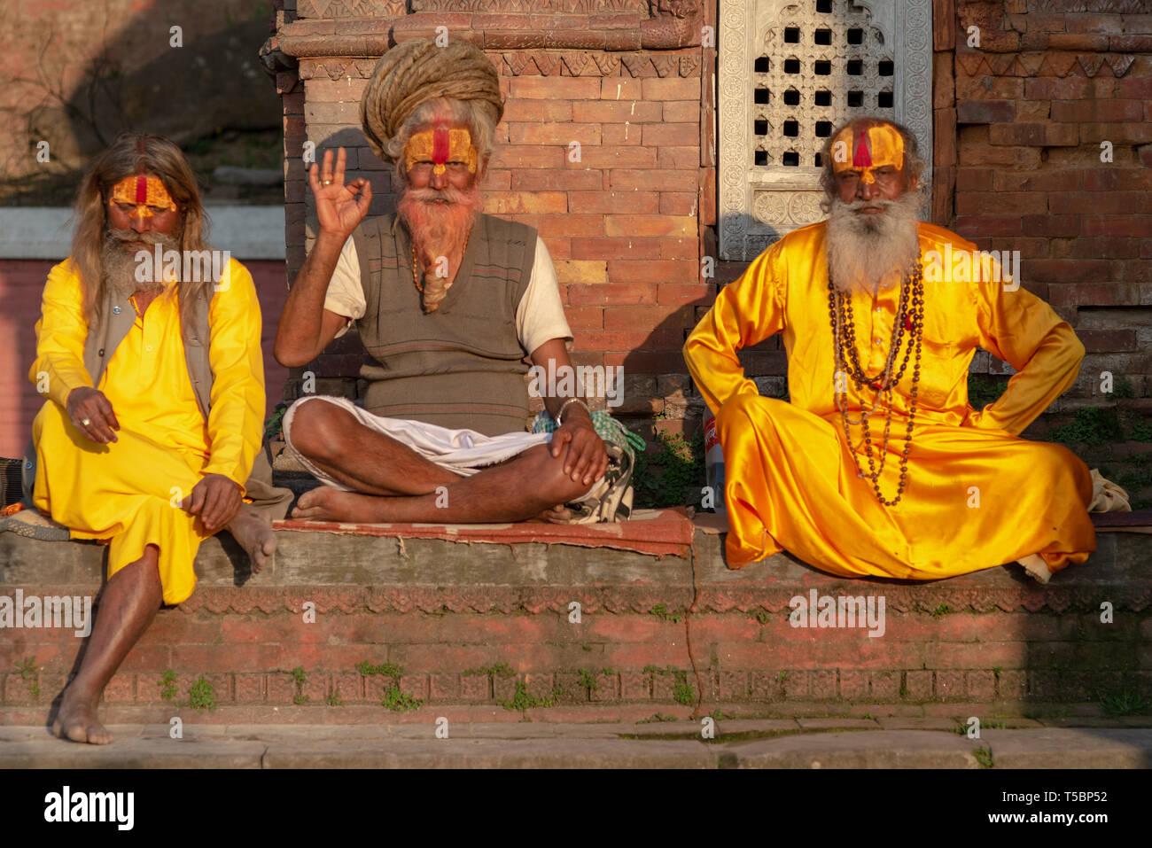 TILGANGA, KATHMANDU, NEPAL - APRIL 2, 2019: a group of 3 Sadhus posing for the camera - Stock Image