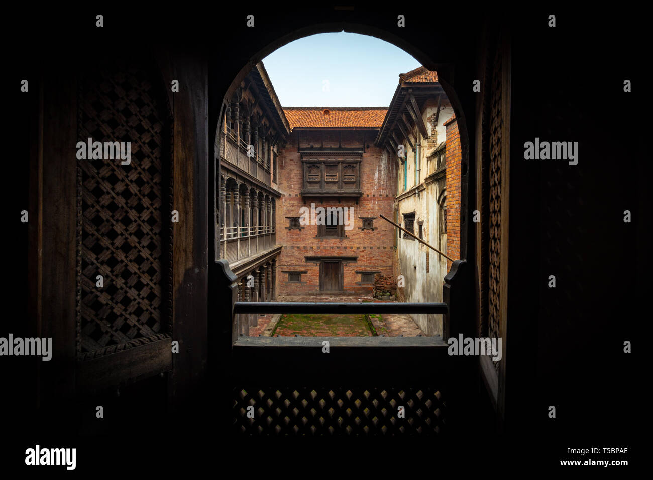 View from an obscure room on one of the internal courtyard of the 55 Window Palace located in the historical center of Bhaktapur, Nepal - Stock Image