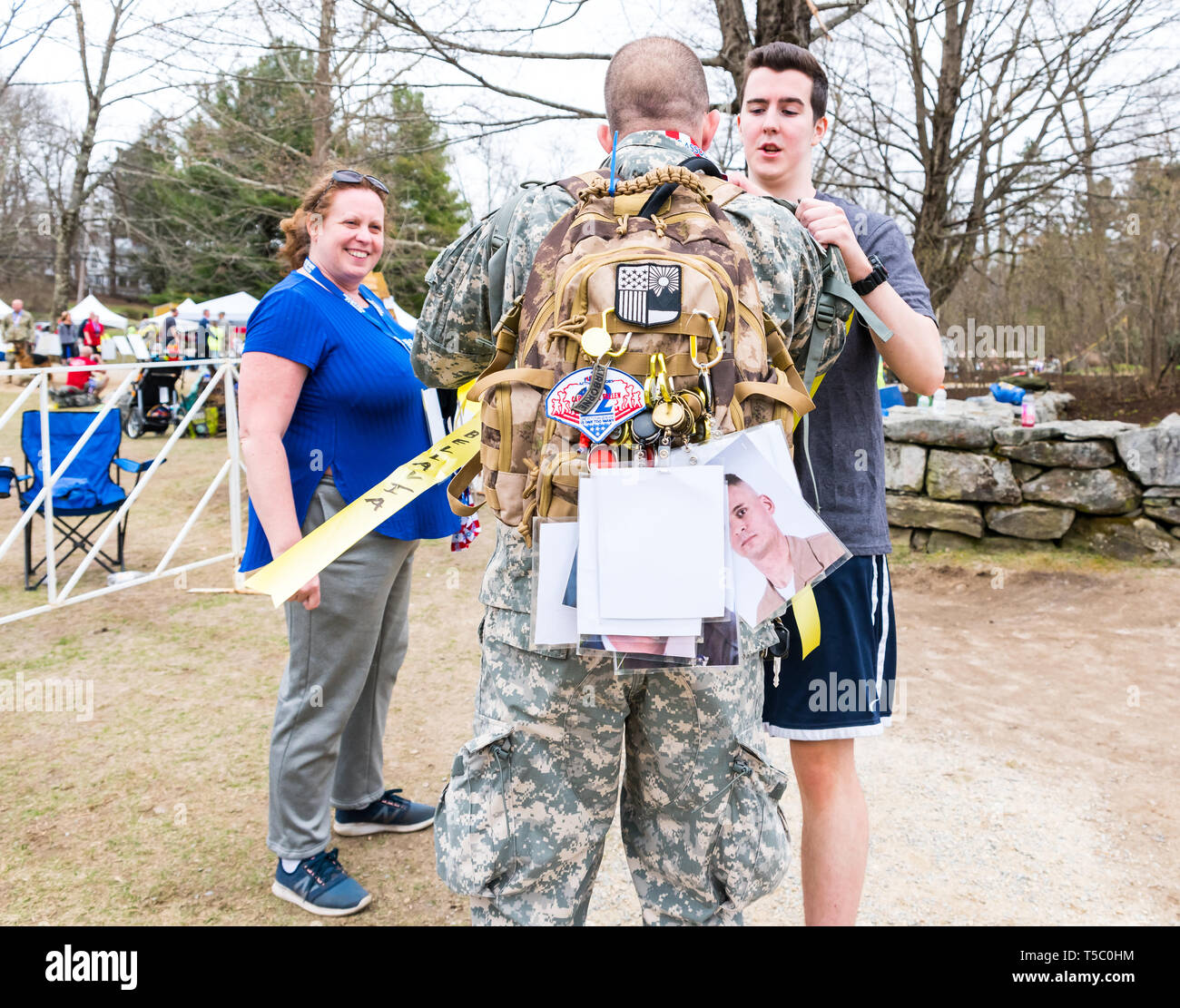 Soldier participating in the Tough Ruck, who crossed the marathon finish line carrying not only his ruck sack but also one belonging to another. - Stock Image