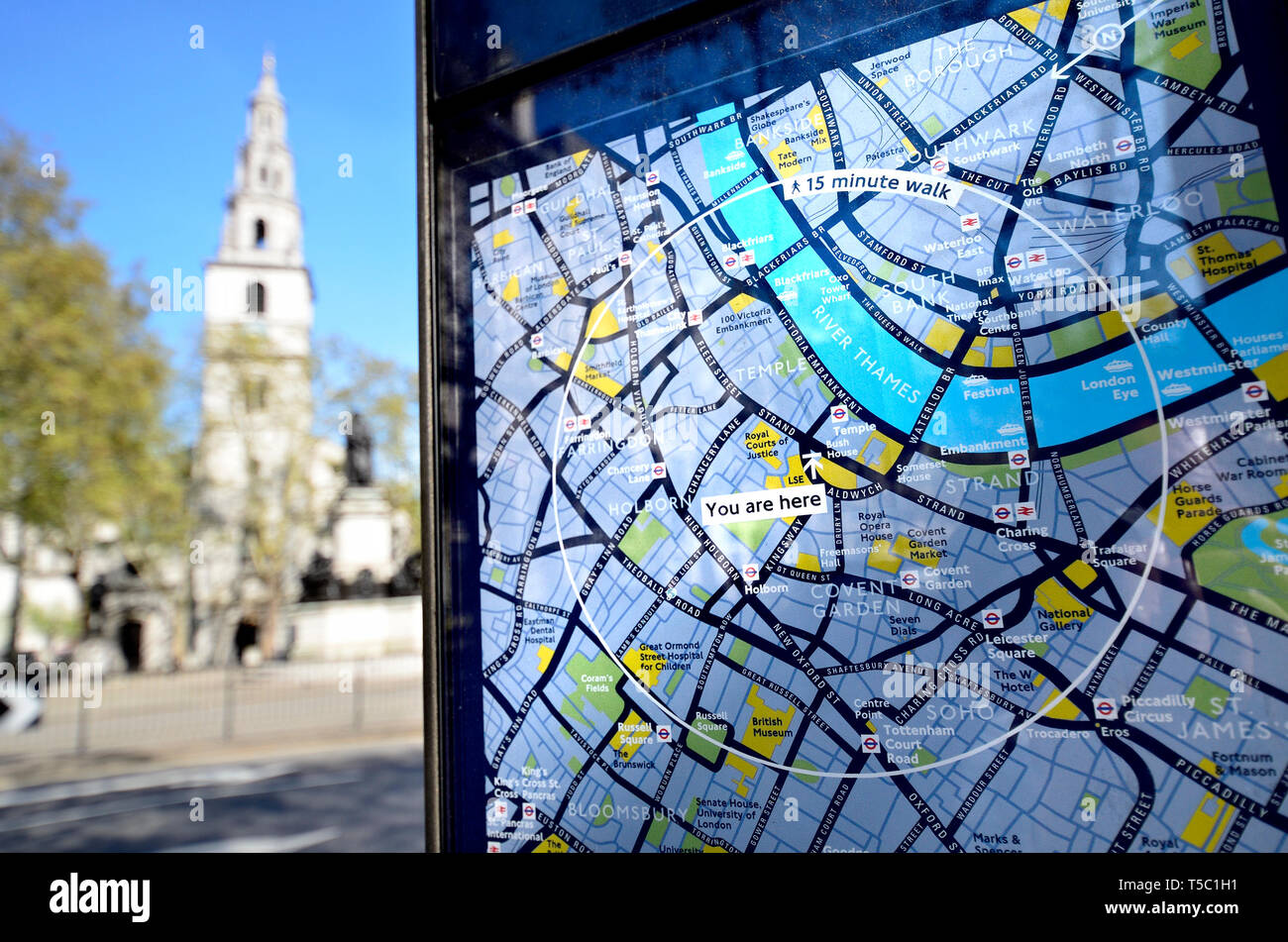 London, England, UK. Tourist information map 'You are Here' - Strand / Bush House - church of St Clement Danes in the background - Stock Image