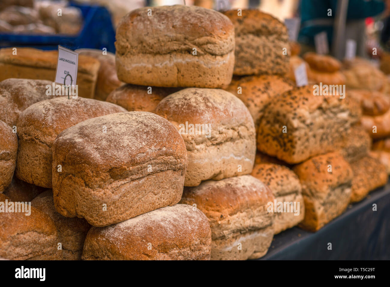 Loaves of Freshly Baked Wholemeal Bread for Sale at a Street Market in England Stock Photo