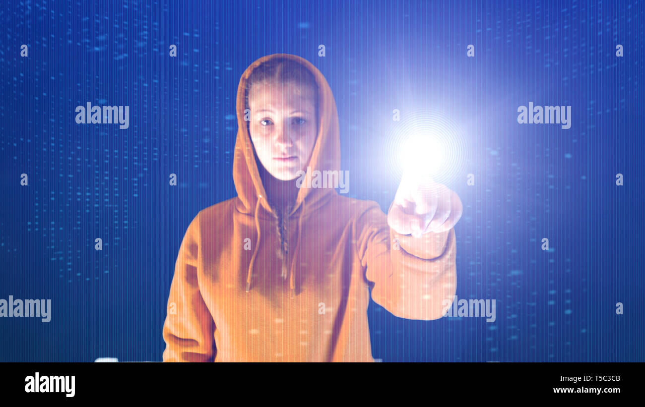 hooded girl points with her hand in a cyberspace digital environment, ideal for topics such as ecology and online safety - Stock Image