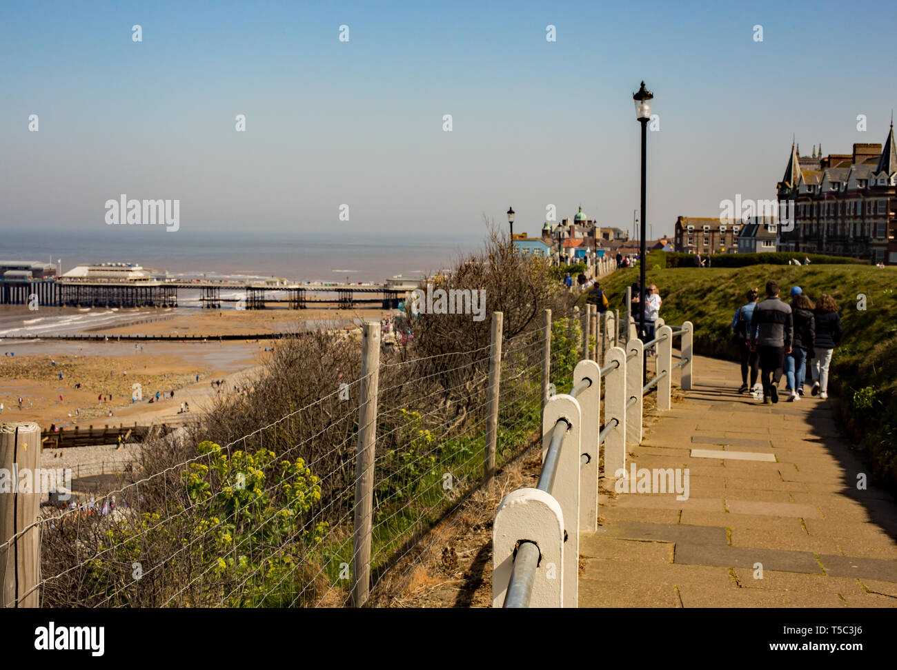 The Norfolk coastal path runs along the cliff tops in Cromer and is a popular path for tourists and holiday makers to reach the town centre from the c - Stock Image