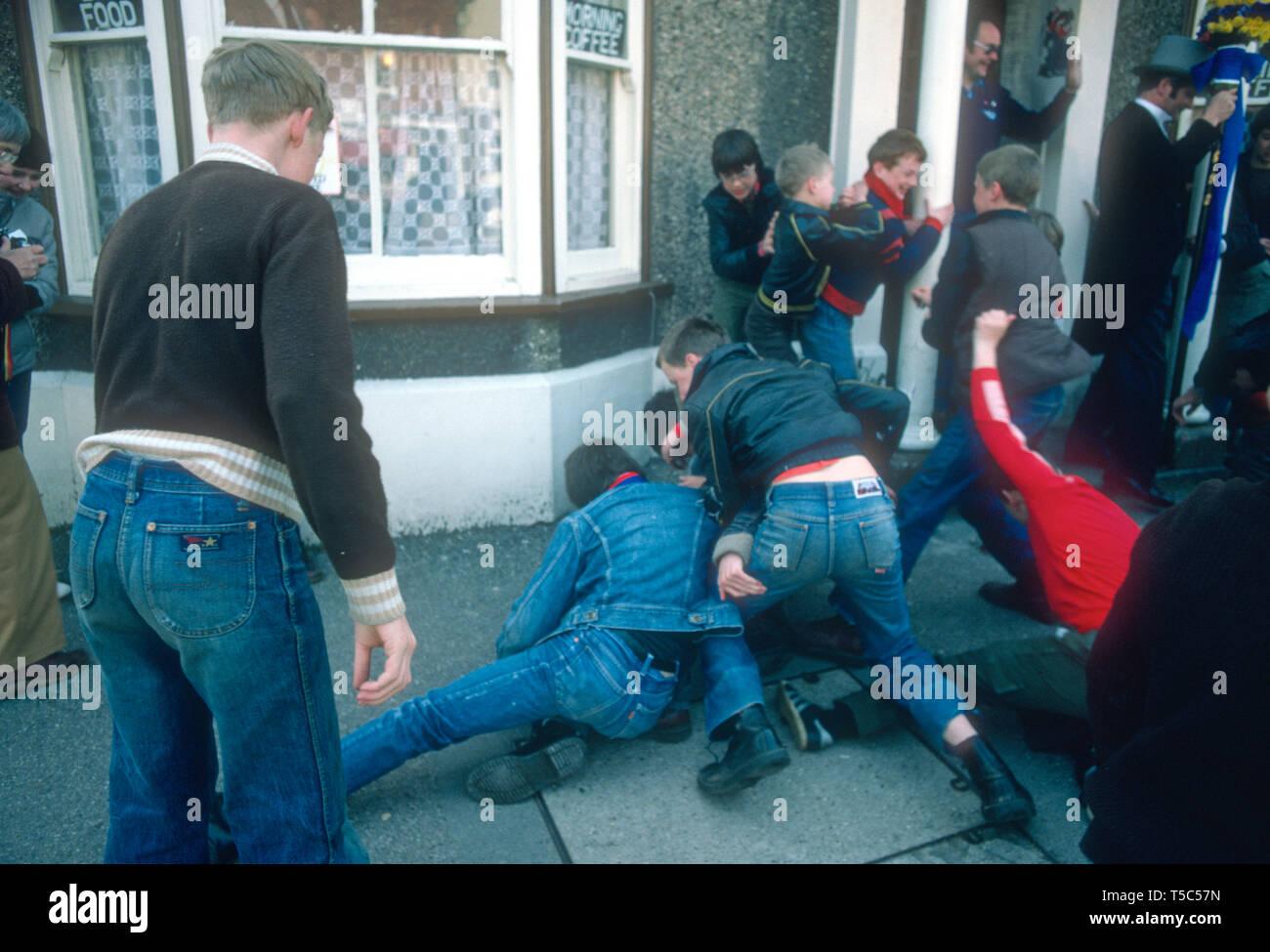 Childeren scramble for pennies at Hungerford Hocktide UK in 1982 - Stock Image