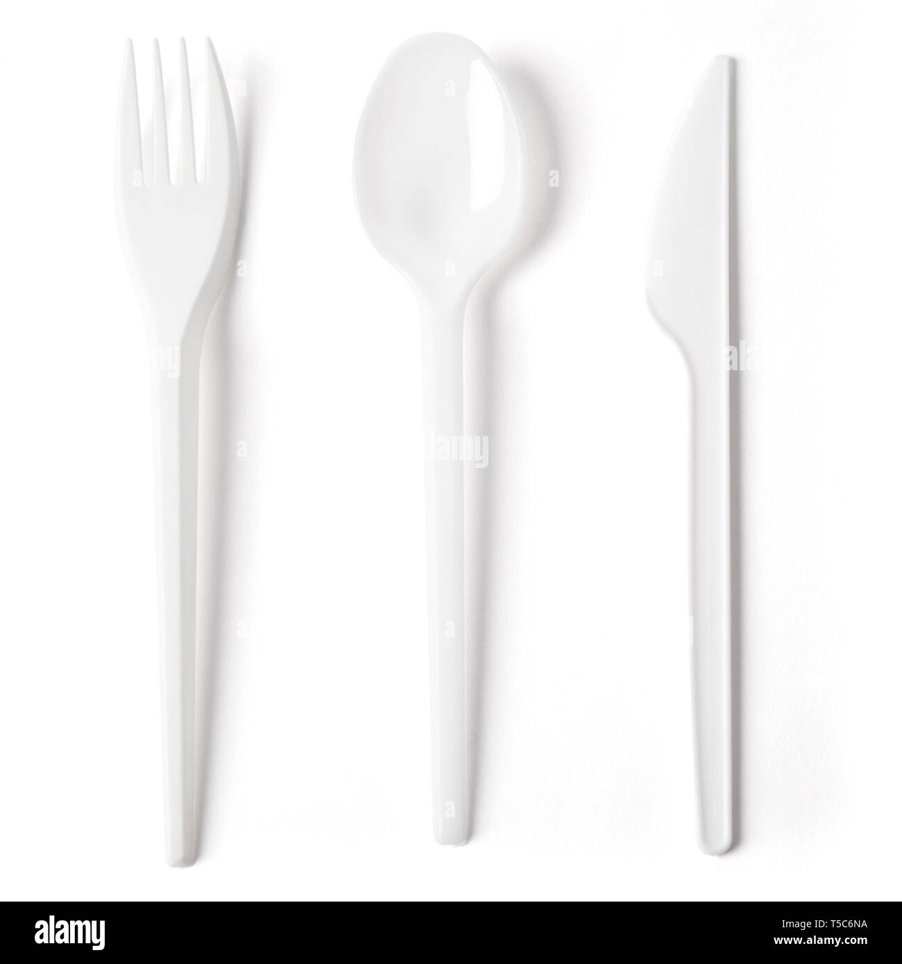 Disposable plastic cutlery fork, spoon and knife with working pats isolated on white. - Stock Image