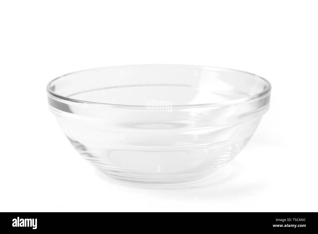 Transparent empty glass bowl for soup and salad, with a path isolated on white background. Stock Photo