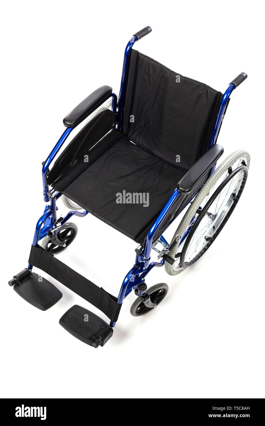 Detail of a classic wheelchair for physical disability on a white background. Concept of hospital care and disability. - Stock Image