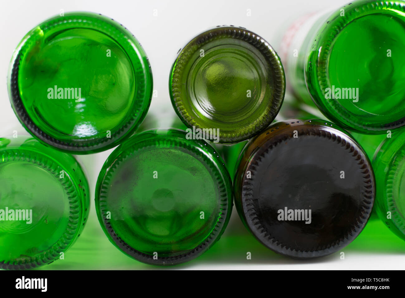 Pack of empty beer and wine green and brown glass bottom bottles, on a white background. Reuse, Eco-Friendly, Environment, Conservation, Sustainable - Stock Image