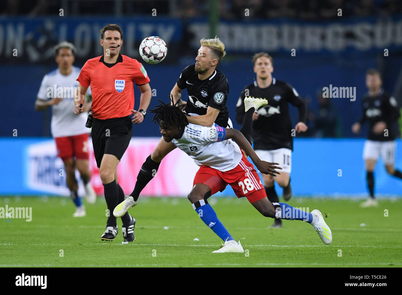HAMBURG, GERMANY - APRIL 23: Gideon Jung (L) of Hamburg and Kevin Kampl (R) of Leipzig competes for the ball during the DFB Pokal semi final match bet - Stock Image