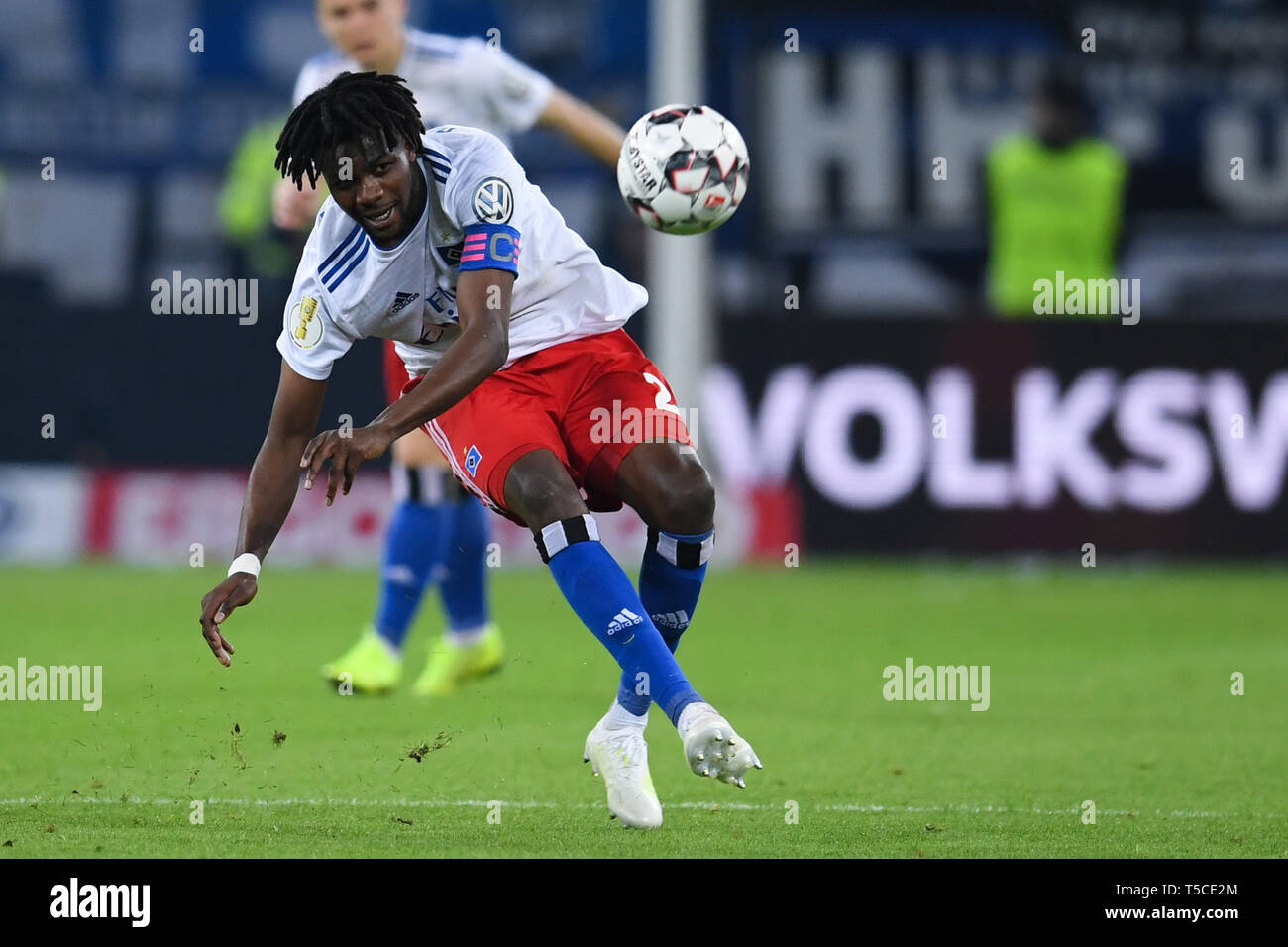 HAMBURG, GERMANY - APRIL 23: Gideon Jung of Hamburg runs with the ball during the DFB Pokal semi final match between Hamburger Sport Verein and Rasen  - Stock Image