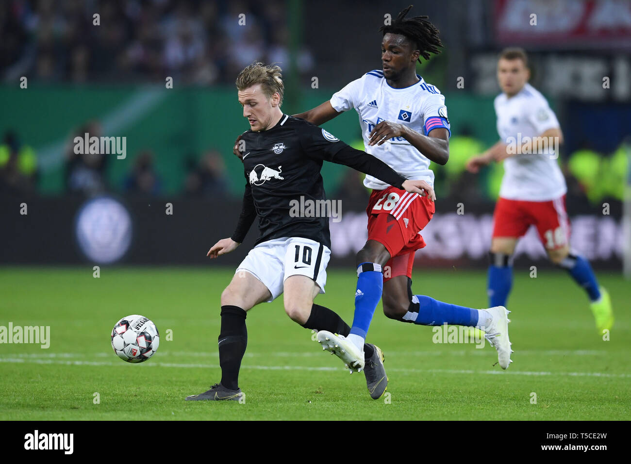HAMBURG, GERMANY - APRIL 23: Gideon Jung (R) of Hamburg and Emil Forsberg (L) of Leipzig competes for the ball during the DFB Pokal semi final match b - Stock Image