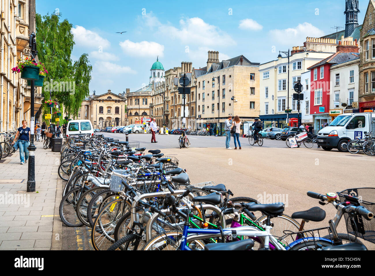 Walking people and parked bicycles on Broad Street. Oxford, England Stock Photo