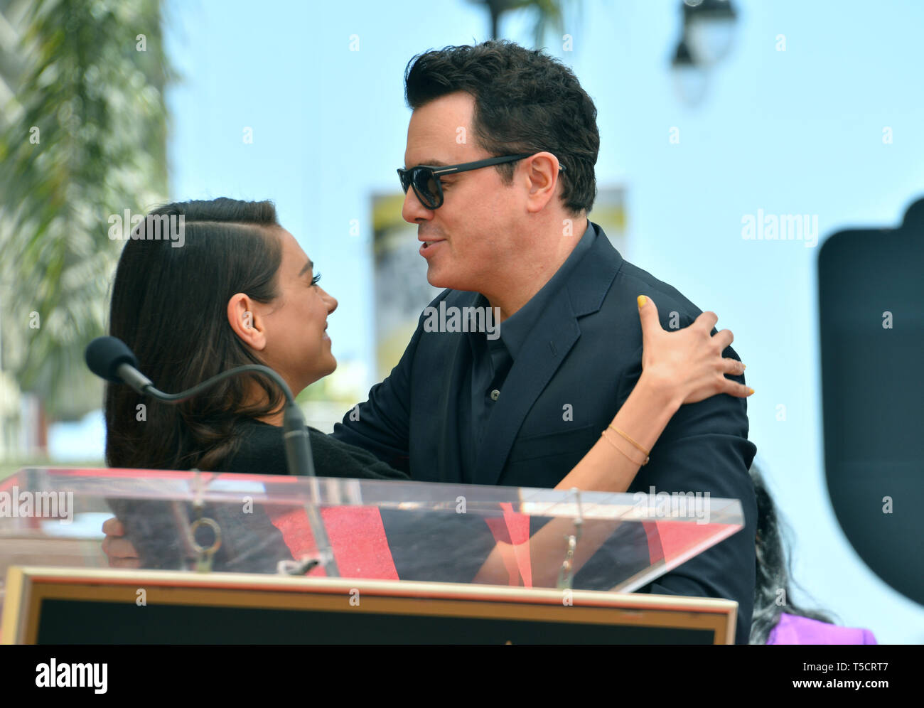Los Angeles, USA. 23rd Apr, 2019. LOS ANGELES, USA. April 23, 2019: Seth MacFarlane & Mila Kunis at the Hollywood Walk of Fame Star Ceremony honoring actor, animator and comedian Seth MacFarlane. Picture Credit: Paul Smith/Alamy Live News - Stock Image