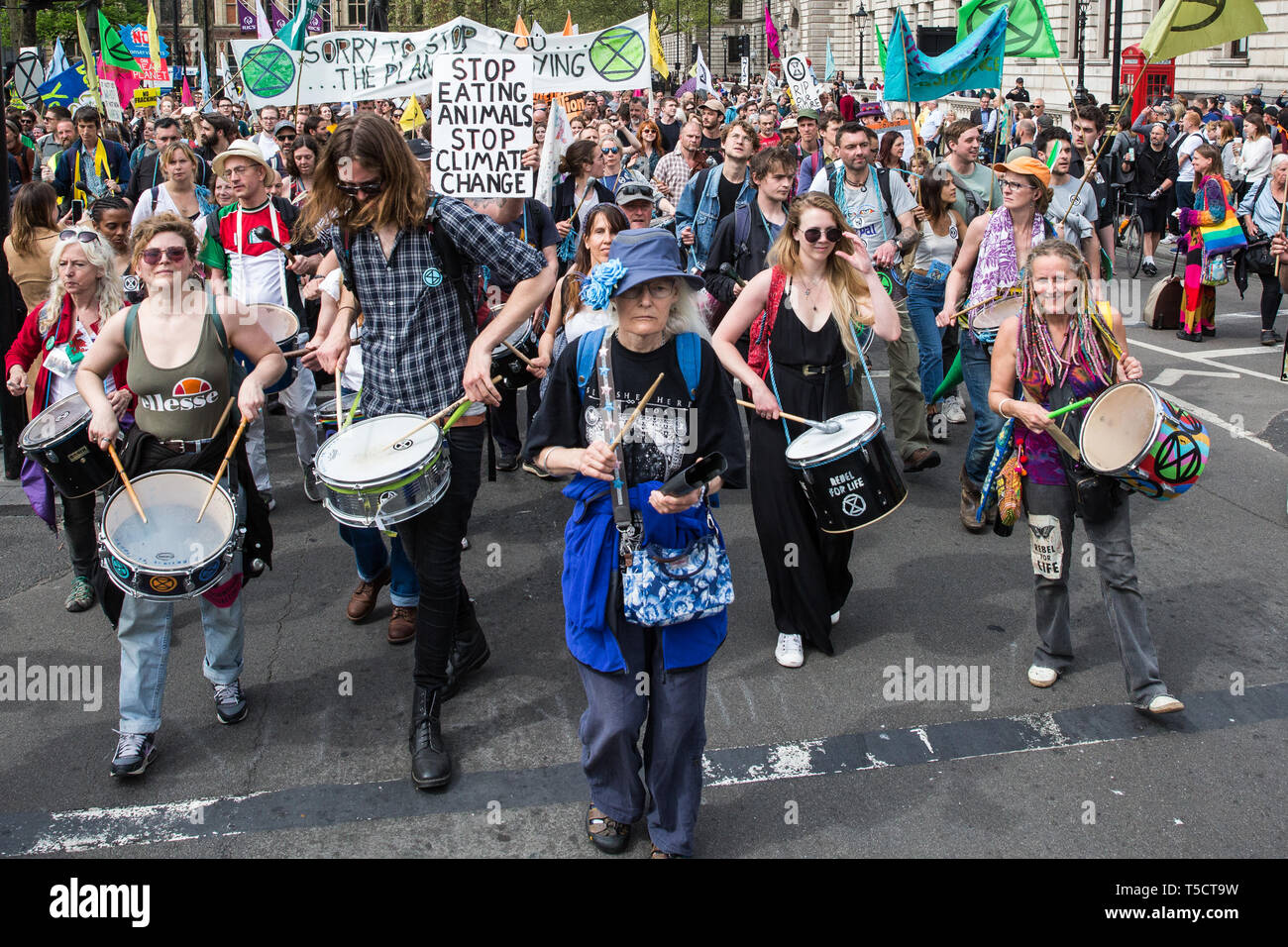 London, UK. 23rd April 2019. The XR Samba Band marches in front of fellow climate change activists from Extinction Rebellion in Parliament Square prior to an assembly and the preparation of letters requesting meetings with Members of Parliament. Credit: Mark Kerrison/Alamy Live News - Stock Image