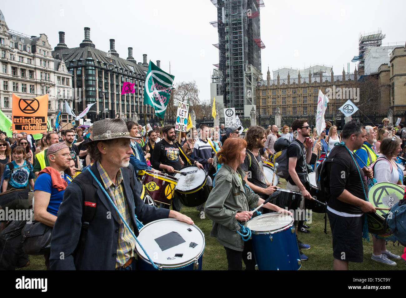 London, UK. 23rd April 2019. The XR Samba Band marches into Parliament Square with fellow climate change activists from Extinction Rebellion for an assembly and the preparation of letters requesting meetings with Members of Parliament. Credit: Mark Kerrison/Alamy Live News - Stock Image