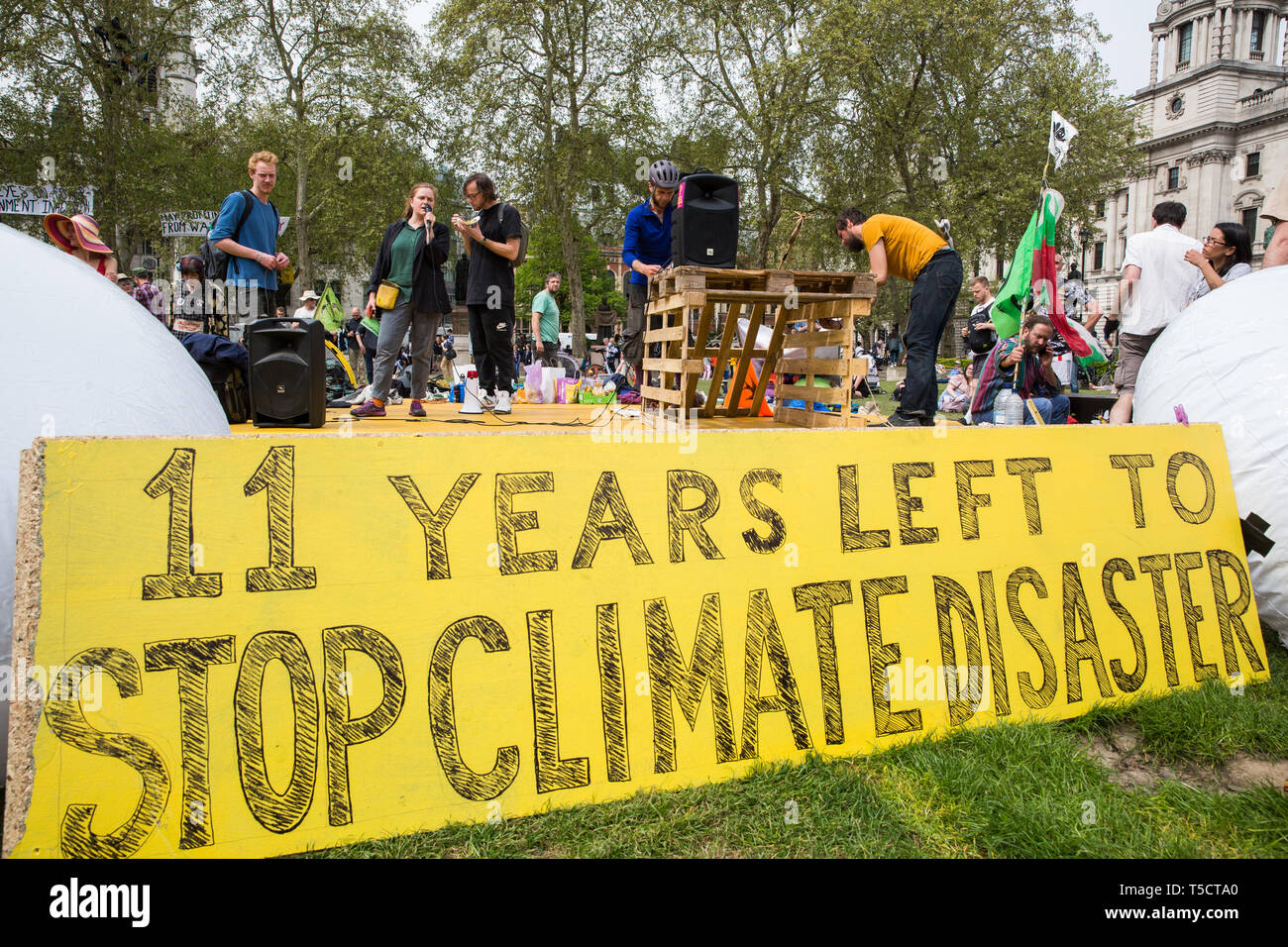 London, UK. 23rd April 2019. Climate change activists from Extinction Rebellion address an assembly in Parliament Square prior to the preparation of letters for delivery to their Members of Parliament. Credit: Mark Kerrison/Alamy Live News - Stock Image