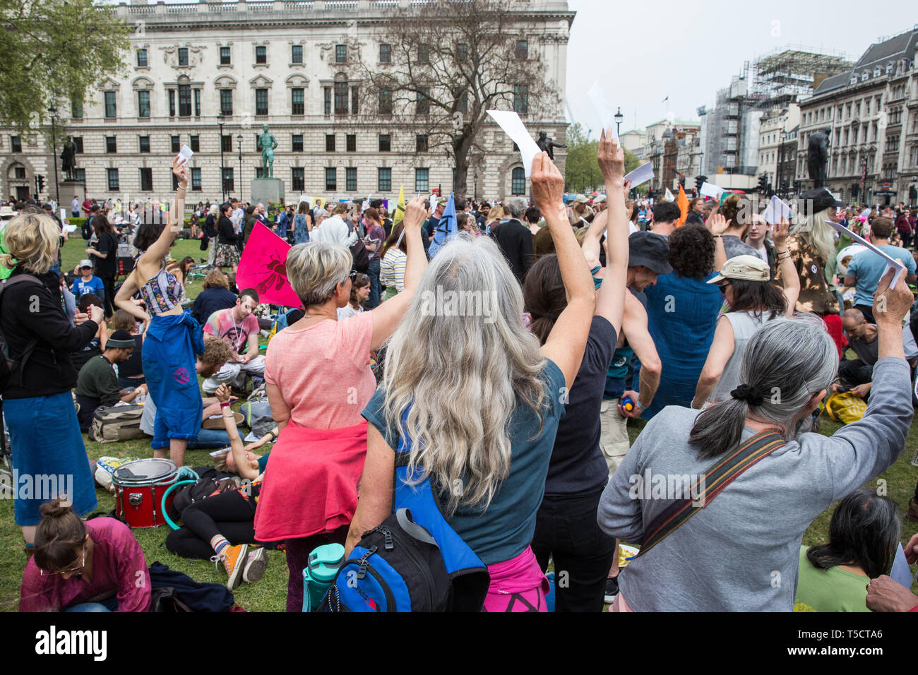 London, UK. 23rd April 2019. Climate change activists from Extinction Rebellion attending an assembly in Parliament Square hold up letters to their Members of Parliament requesting meetings to discuss the issue of climate change. Activists later tried to deliver their letters to Parliament, but all but ten were prevented from doing so by the Metropolitan Police. Credit: Mark Kerrison/Alamy Live News - Stock Image