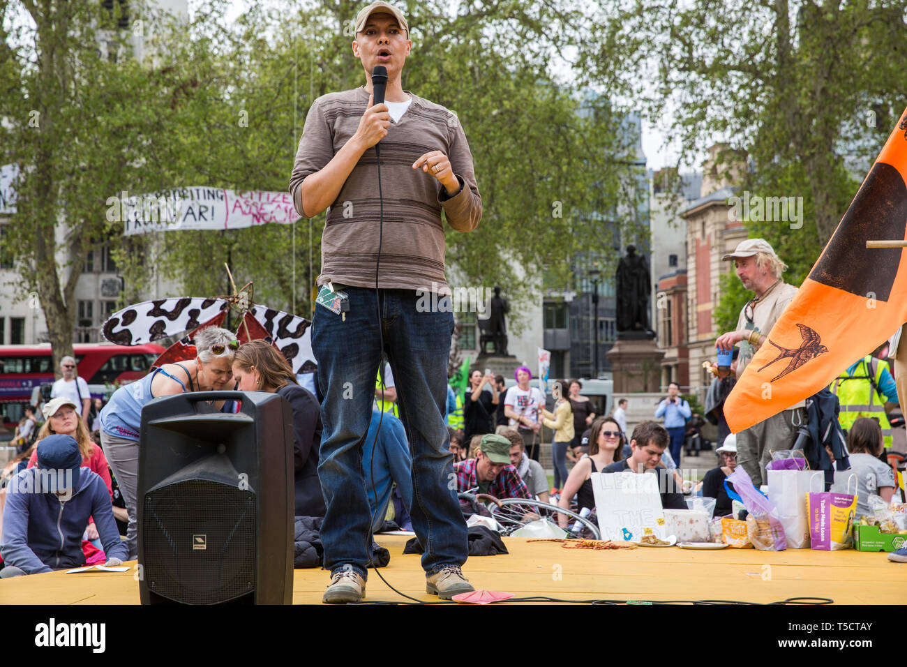 London, UK. 23rd April 2019. Clive Lewis MP, Shadow Minister for Sustainable Economics, addresses climate change activists from Extinction Rebellion at an assembly in Parliament Square prior to an attempt to deliver to Parliament activists' letters requesting meetings to discuss climate change with their Members of Parliament. Credit: Mark Kerrison/Alamy Live News - Stock Image