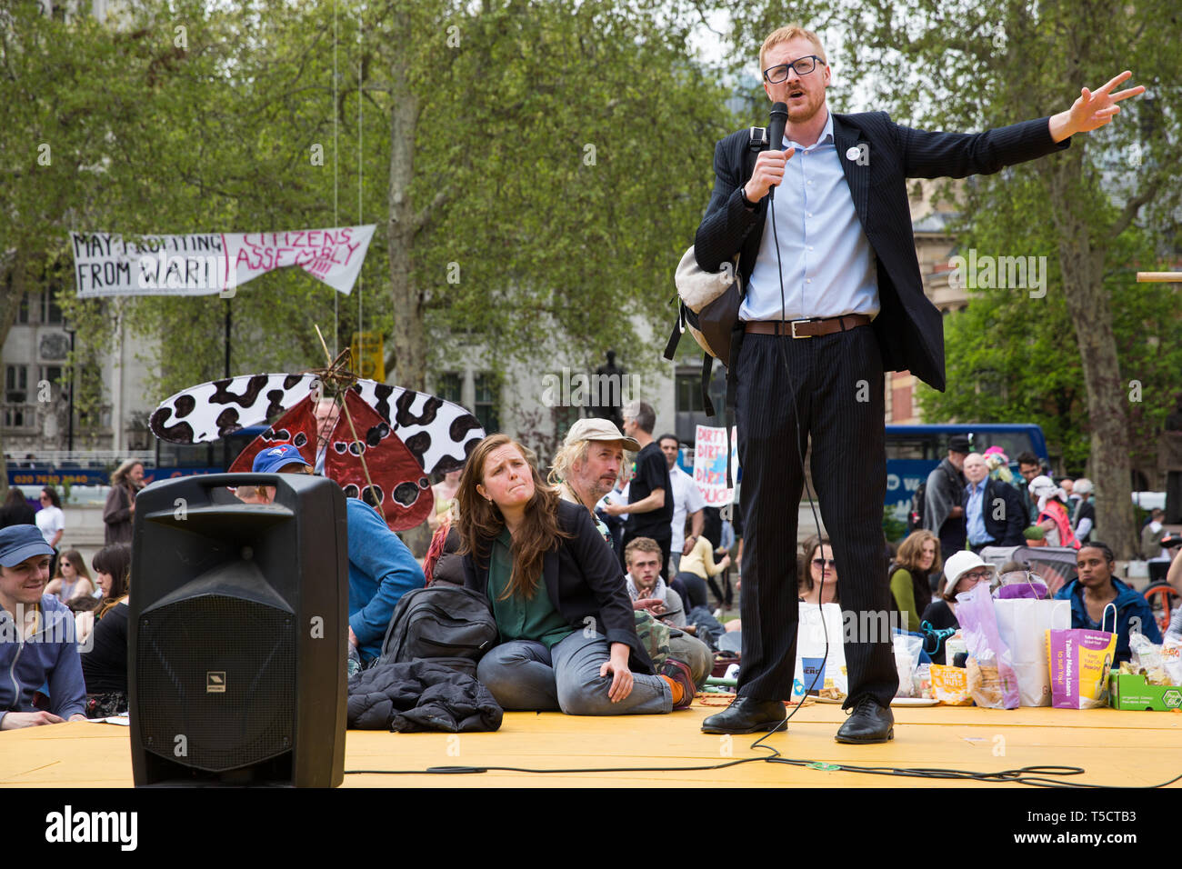 London, UK. 23rd April 2019. Lloyd Russell-Moyle, Labour MP for Brighton Kemptown, addresses climate change activists from Extinction Rebellion at an assembly in Parliament Square prior to an attempt to deliver to Parliament activists' letters requesting meetings to discuss climate change with their Members of Parliament. Credit: Mark Kerrison/Alamy Live News - Stock Image