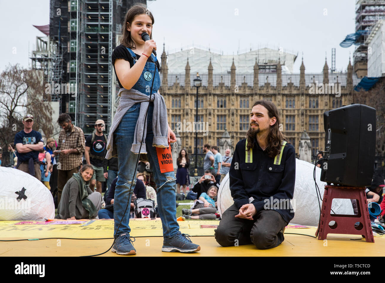 London, UK. 23rd April 2019. A 12-year-old school striker addresses climate change activists from Extinction Rebellion at an assembly in Parliament Square to discuss the preparation and delivery of activists' letters requesting meetings to discuss climate change with Members of Parliament. Credit: Mark Kerrison/Alamy Live News - Stock Image