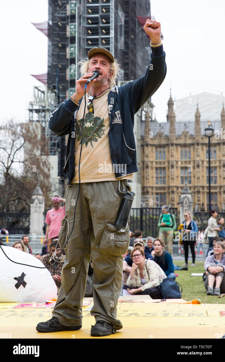London, UK. 23rd April 2019. Activist Phoenix addresses fellow climate change activists from Extinction Rebellion at an assembly in Parliament Square to discuss the preparation and delivery of activists' letters requesting meetings to discuss climate change with Members of Parliament. Credit: Mark Kerrison/Alamy Live News - Stock Image