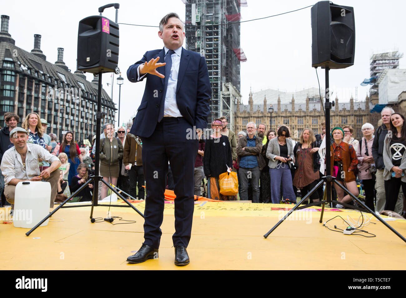 London, UK. 23rd April 2019. Jon Ashworth MP, Shadow Health Minister, addresses climate change activists from Extinction Rebellion at an assembly in Parliament Square prior to an attempt to deliver to Parliament activists' letters requesting meetings to discuss climate change with their Members of Parliament. Credit: Mark Kerrison/Alamy Live News - Stock Image