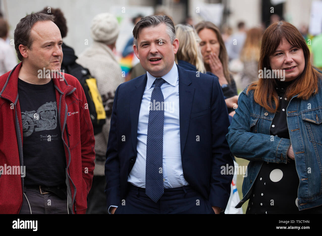 London, UK. 23rd April 2019. Jon Ashworth MP, Shadow Health Minister, prepares to address climate change activists from Extinction Rebellion at an assembly in Parliament Square prior to an attempt to deliver to Parliament activists' letters requesting meetings to discuss climate change with their Members of Parliament. Credit: Mark Kerrison/Alamy Live News - Stock Image