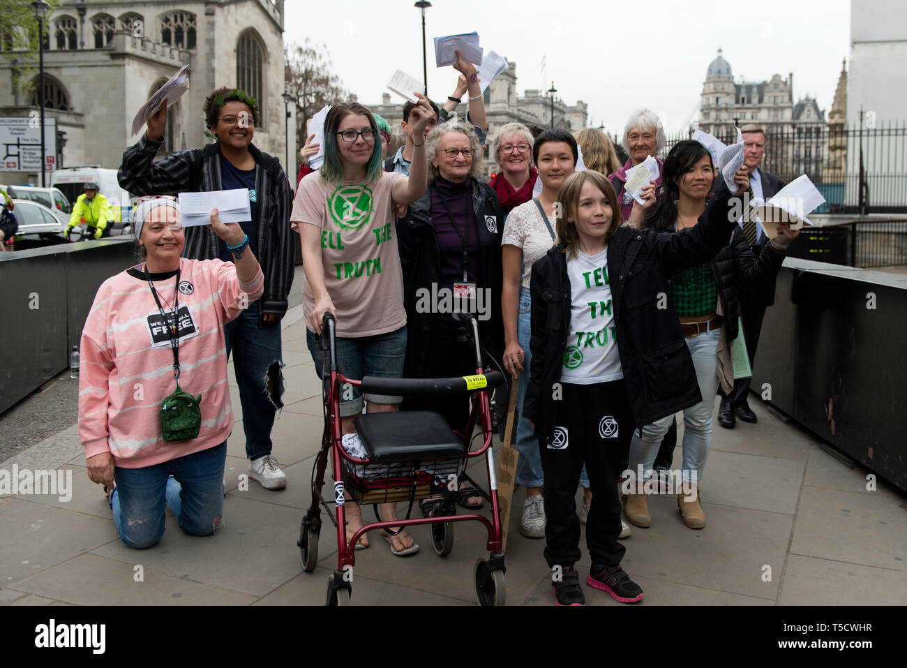 Baroness Jenny Jones (centre) walking to Parliament with ten Extinction Rebellion protester selected to deliver letters to the MPs.  Extinction Rebellion protesters march from Marble Arch to Parliament Square, attempting to deliver letters to their MPs. Extinction Rebellion activists were permitted to be in Parliament Square but not to enter Parliament. After several attempts to deliver the letters, the activists reached an agreement with MPs through the police. Ten activists were allowed to deliver the letters in the company of Baroness Jenny Jones (Green party). Philosopher and Green campaig - Stock Image