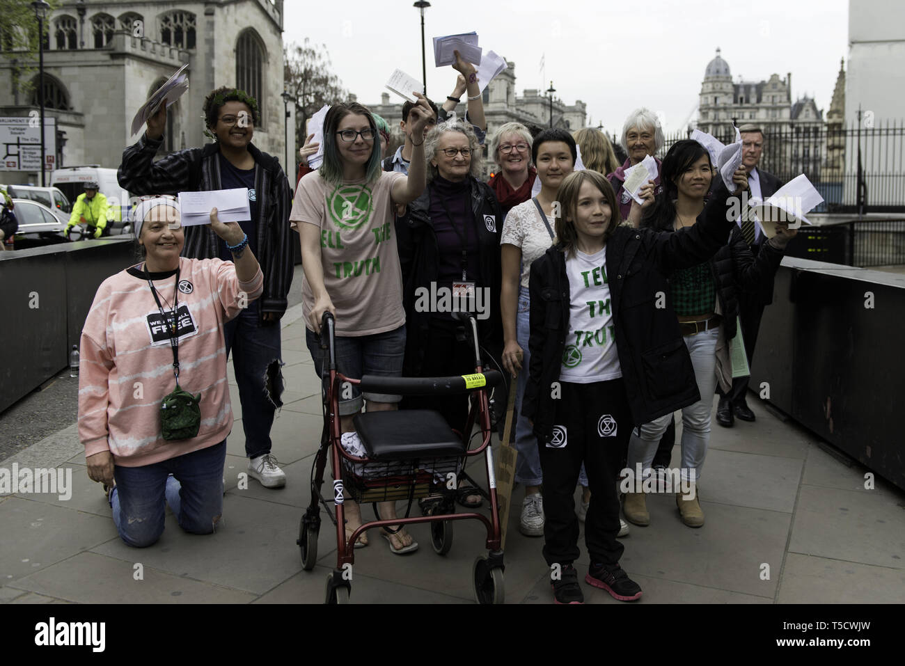 London, Greater London, UK. 23rd Apr, 2019. Baroness Jenny Jones (centre) walking to Parliament with ten Extinction Rebellion protester selected to deliver letters to the MPs.Extinction Rebellion protesters march from Marble Arch to Parliament Square, attempting to deliver letters to their MPs. Extinction Rebellion activists were permitted to be in Parliament Square but not to enter Parliament. After several attempts to deliver the letters, the activists reached an agreement with MPs through the police. Ten activists were allowed to deliver the letters in the company of Barones - Stock Image