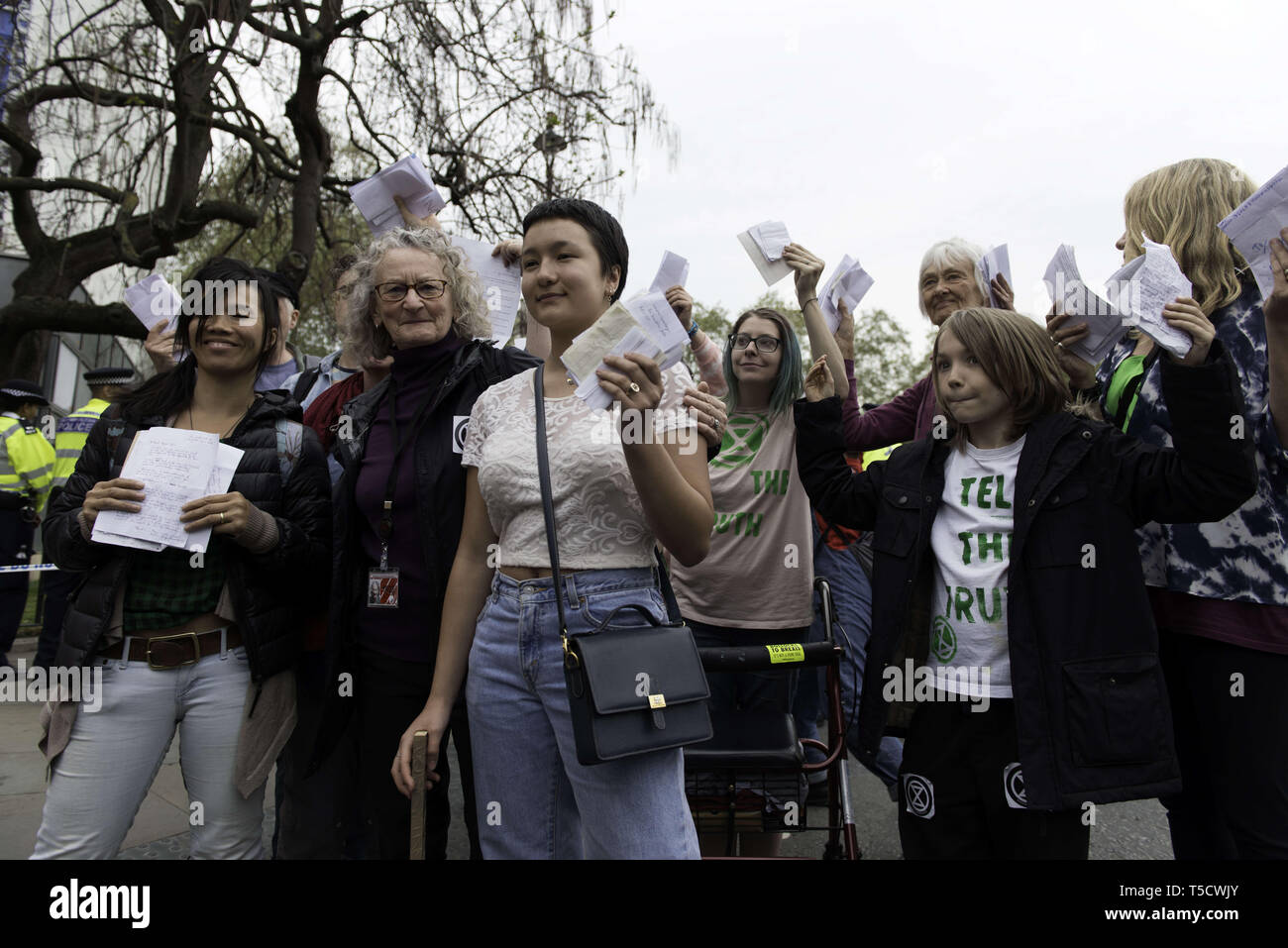London, Greater London, UK. 23rd Apr, 2019. Baroness Jenny Jones (2nd from left) walking to Parliament with ten Extinction Rebellion protesters selected to deliver letters to the MPs .Extinction Rebellion protesters march from Marble Arch to Parliament Square, attempting to deliver letters to their MPs. Extinction Rebellion activists were permitted to be in Parliament Square but not to enter Parliament. After several attempts to deliver the letters, the activists reached an agreement with MPs through the police. Ten activists were allowed to deliver the letters in the company of - Stock Image