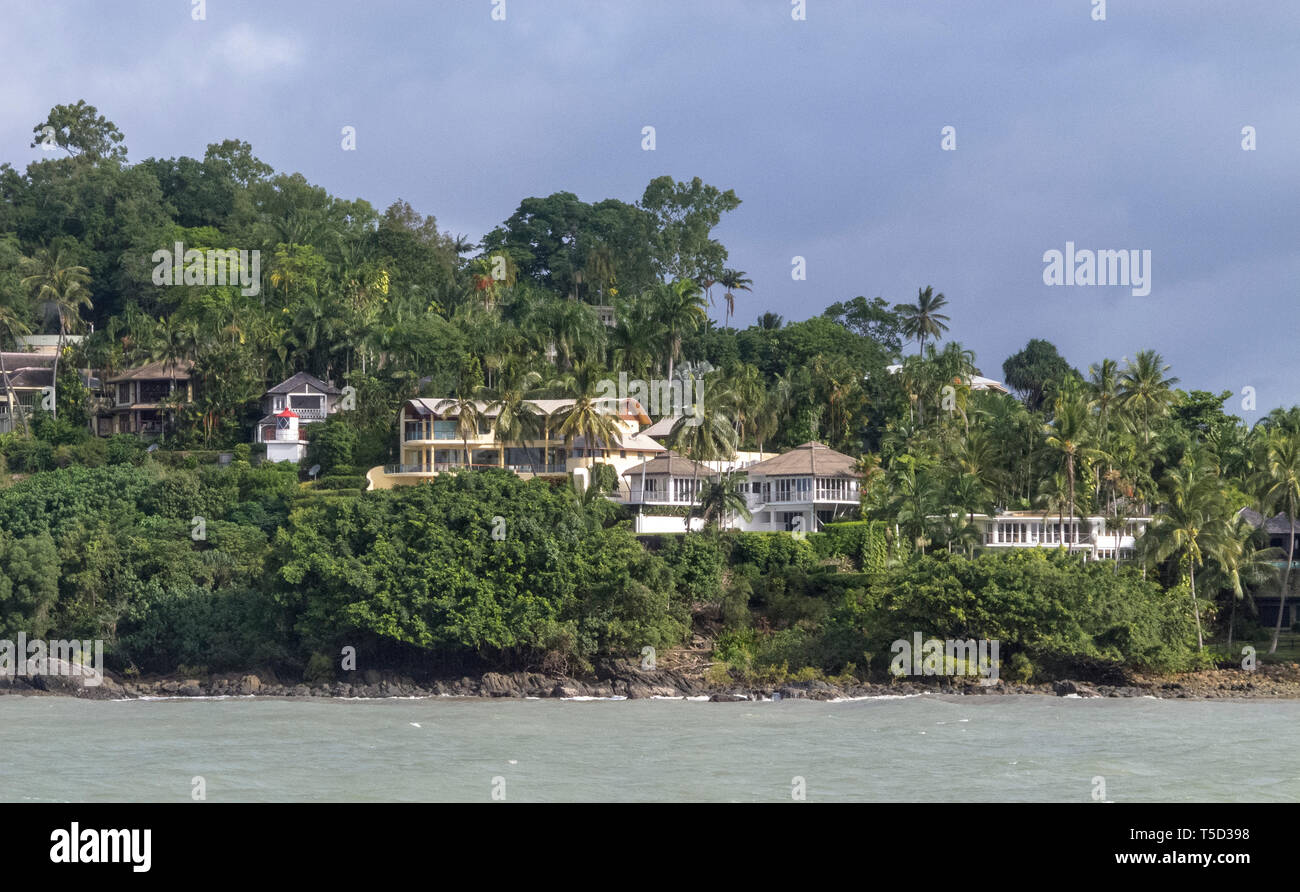 Houses and lighthouse at entry to Port Douglas, Queensland, Australia - Stock Image
